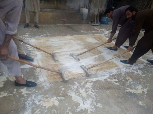 A rug being washed in Lahore 2005 Image NC Larsen