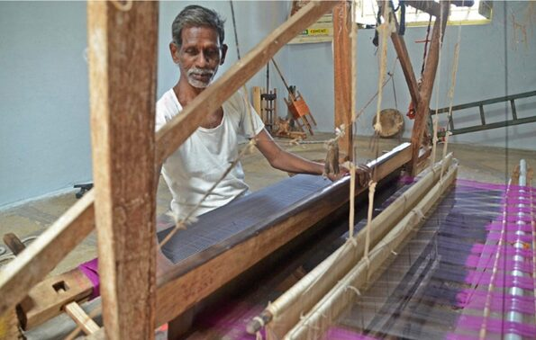 An Indian weaver using a simple hand loom Image NC Larsen